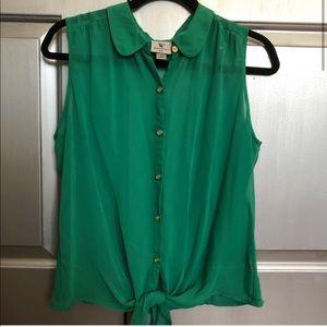 Green sleeveless tie blouse